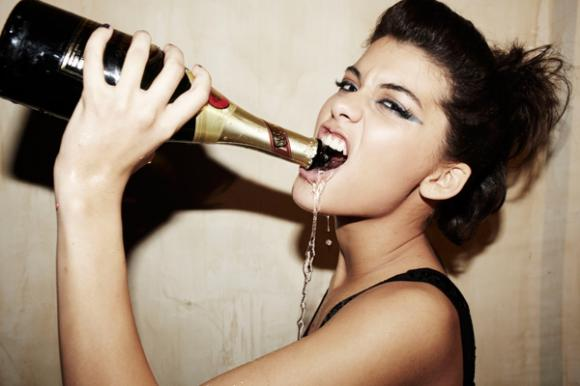 Woman chugging champagne