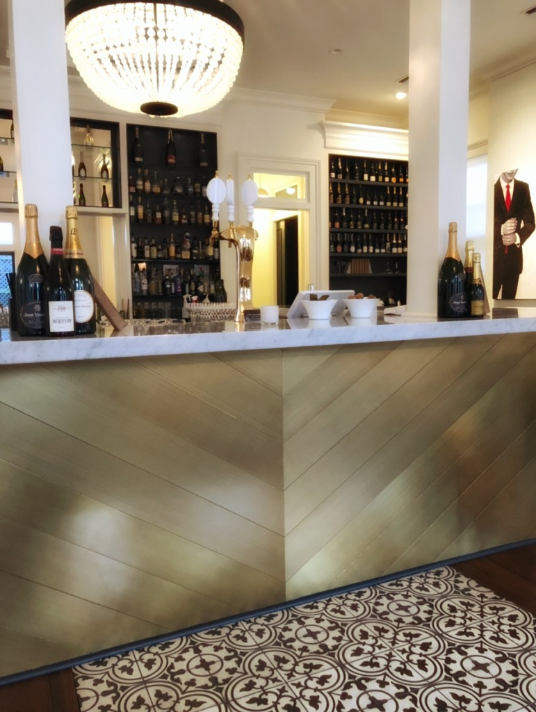 Gold and marble bar at Effervescence champagne bar in New Orleans