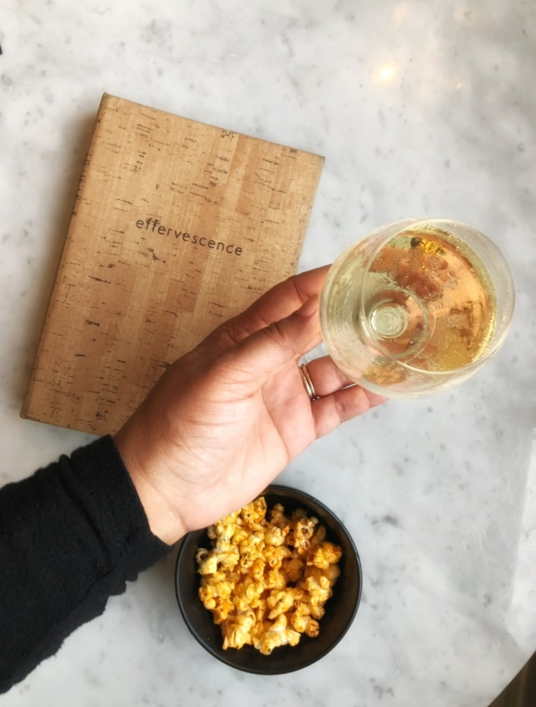 Glass of champagne an popcorn at Effervescence Champagne bar