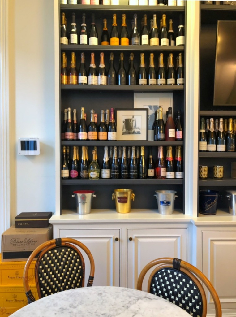 Shelf after shelf of champagne at Effervescence champagne bar in New Orleans
