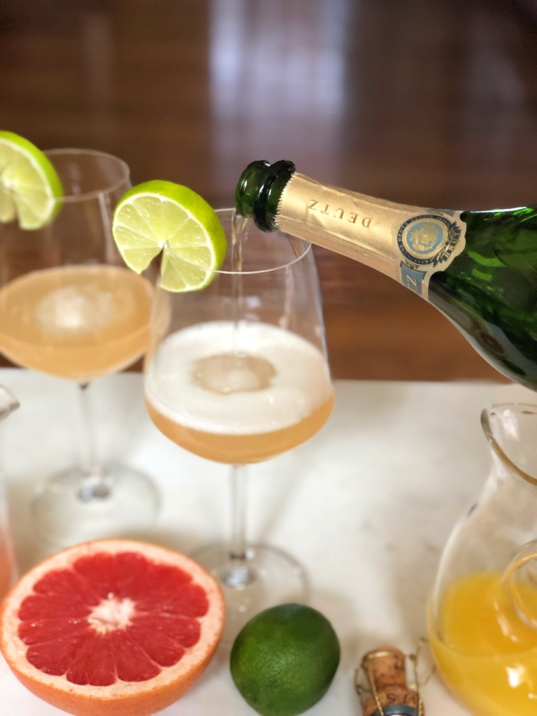 PALOMIMOSA-pouring champagne into glass