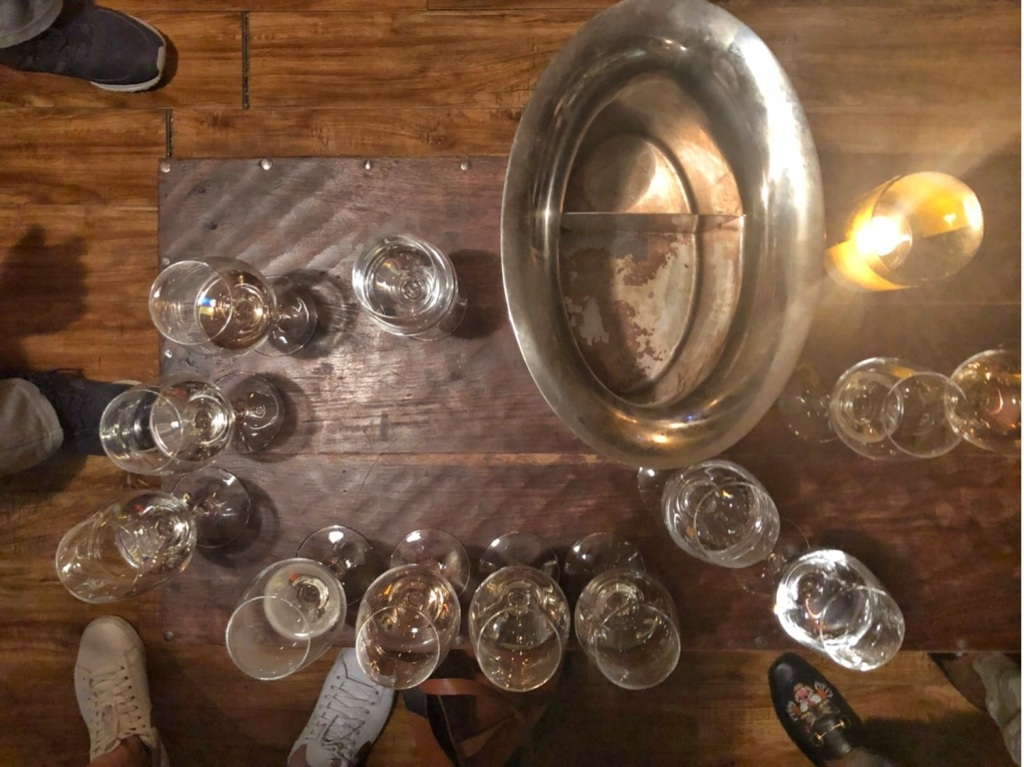 aerial shot of wine glasses and spit bucket