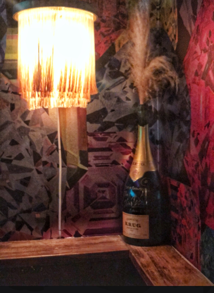 AIRS krug bottle and feather