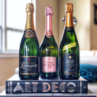 Photo of 3 bottles of champagne with books